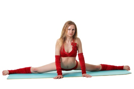 Young gymnast girl doing exercises photo