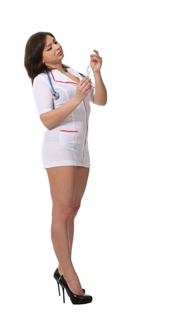 Young attractive nurse hold a syringe