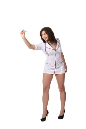Young attractive nurse play darts with a syringe photo