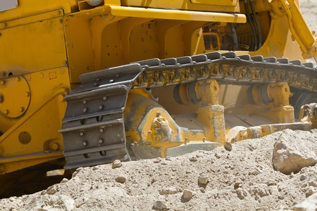 Bulldozer clears road in the Indian Himalayas Stock Photo