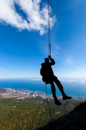 rappelling: Silhouette of a rappelling man