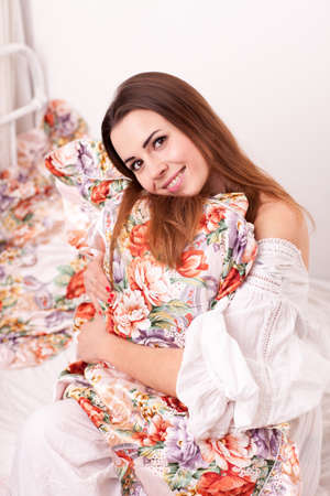 Young attractive girl sit in a bed Stock Photo - 17387053