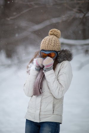 Girl playing in the snow Stock Photo - 17546539