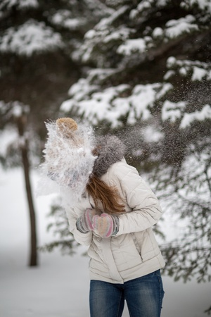 Girl playing in the snow photo