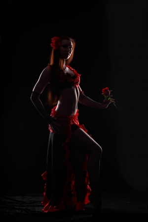 Attractive woman dance in the darkness Stock Photo