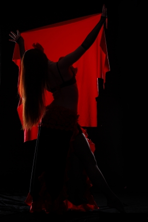 Attractive woman dance in the darkness photo