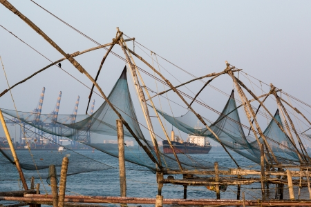 famous industries: Chinese fishnets on sunset. Kochi, Kerala, India Editorial