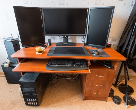 Powerful graphics station with three monitors and a graphics tablet Stock Photo - 20041642