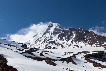 snowcapped: Mountain Kazbek in the clouds  Georgia