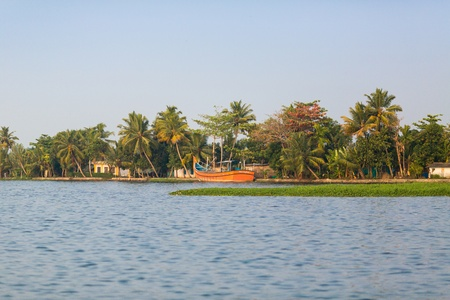 Moored boat on the canal system in the Indian state of Kerala photo