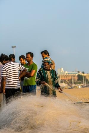 india fisherman: CHENAI, INDIA - FEBRUARY 10  Indian fisherman on the Marina beach at morning Editorial