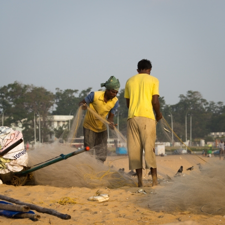 india fisherman: CHENAI, INDIA - FEBRUARY 10  Indian fisherman on the Marina beach at morning Editorial