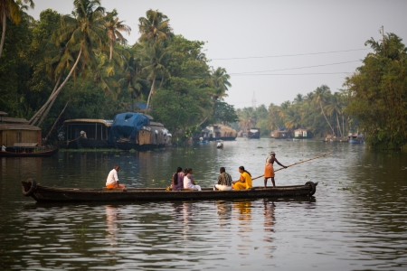 riverside county: Boaters on the river channels province of Kerala