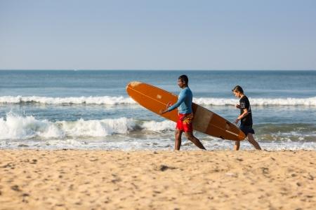 varkala: Surfing in the Indian Ocean near the town of Varkala Editorial