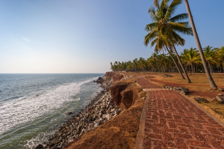 Surfing in the Indian Ocean near the town of Varkala photo