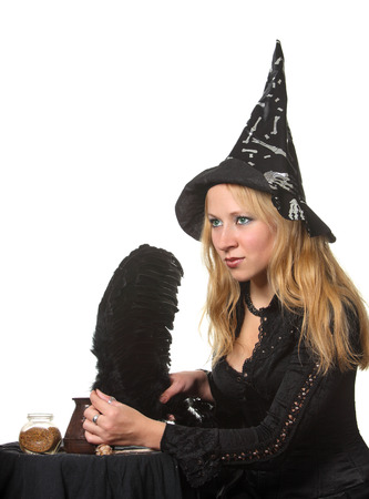 Young girl in witch costume photo