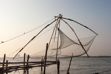 fishnets: Chinese fishnets on sunset. Kochi, Kerala, India Stock Photo