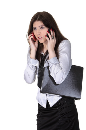 Angry young businesswoman speak two phones photo