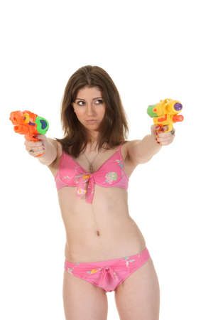 watergun: Attractive young woman in the pink bikini hold two squirt guns