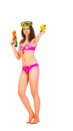 woman squirt: Attractive young woman in the pink bikini hold two squirt guns