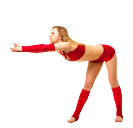 Young gymnast girl doing exercises photo