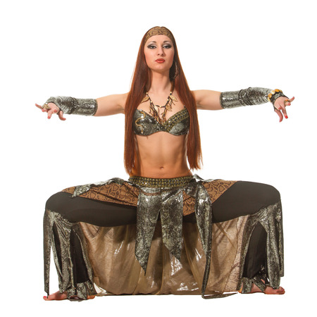 Woman in a snake costume dance in a tribal style photo