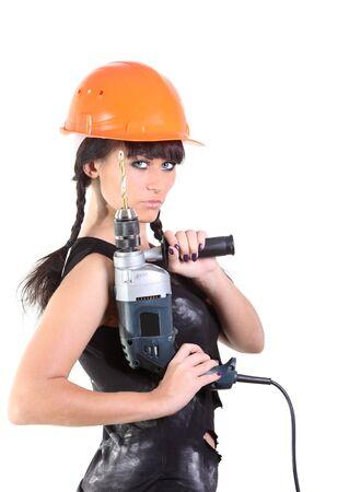 Girl in an orrange hard hat hold a drill photo