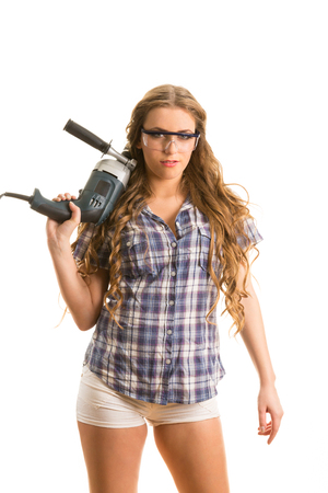 perforator: Young girl in a glasses hold a perforator. Isolated on the white background