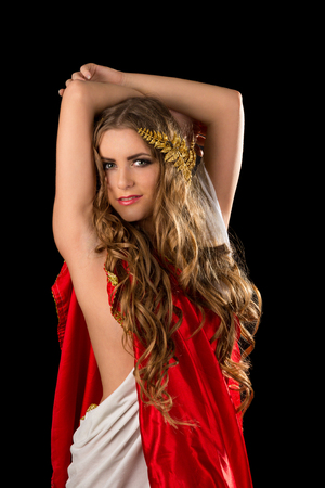 Ancient godness in a red greece toga isolated on a black background photo
