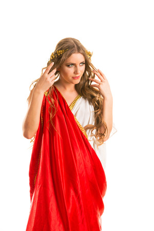 Ancient godness in a red greece toga isolated on a white background photo