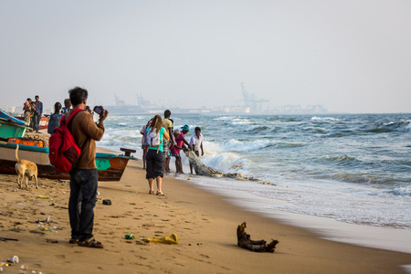 CHENNAI, INDIA-FEBRUARY 10: Fishermen on the beach Marina Beach on February 10, 2013 in Chennai, India. The beach runs from near Fort St. George in the north to Besant Nagar in the south, a distance of 13 km.