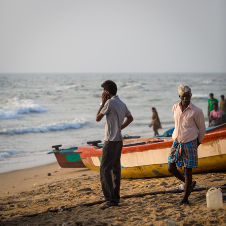 shallop: CHENNAI, INDIA-FEBRUARY 10: Fishermen on the beach Marina Beach on February 10, 2013 in Chennai, India. The beach runs from near Fort St. George in the north to Besant Nagar in the south, a distance of 13km.