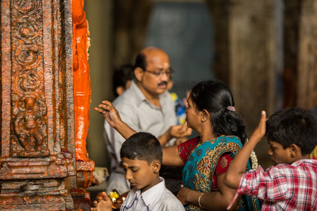 MADURAI, INDIA-FEBRUARY 16: Prayer in Indian temple on February 16, 2013 in Madurai, India. Believer prays in Indian temple