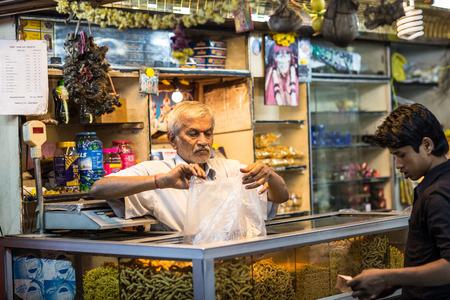 CHENNAI, INDIA-FEBRUARY 9: Trader on the street of Indian town on February 9, 2013 in Chennai, India. Trader on a city street province Tamil Nadu