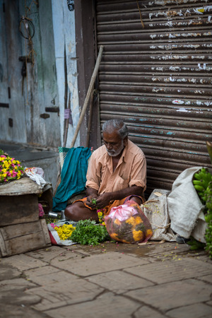 TRICHY, INDIA-FEBRUARY 14: Trader on the street of Indian town on February 14, 2013 in Trichy, India. Trader on a city street province Tamil Nadu