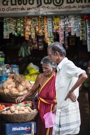 MADURAI, INDIA-FEBRUARY 15: Trader on the street of Indian town on February 15, 2013 in Madurai, India. Trader on a city street province Tamil Nadu