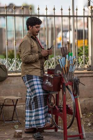 MADURAI, INDIA-FEBRUARY 16: Trader on the street of Indian town on February 16, 2013 in Madurai, India. Trader on a city street province Tamil Nadu