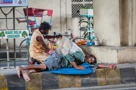 subcontinent: DELHI, INDIA-AUGUST 29: Hindu sleeping on the street on August 29, 2013 in Delhi, India. Hindu man sleeping on the city street