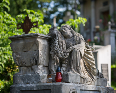 lviv: Satue on grave in the old cemetery Stock Photo