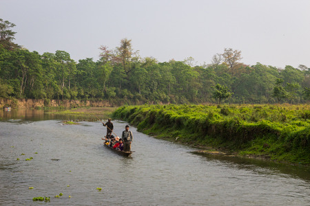 shallop: CHITWAN, NEPAL-MARCH 27: Boat safari 27, 2015 in Chitwan, Nepal. Ð¡anoe safari in the Chitwan National Park., INDIA-