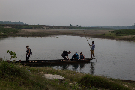 shallop: CHITWAN, NEPAL-MARCH 26: Boat safari 26, 2015 in Chitwan, Nepal. Сanoe safari in the Chitwan National Park., INDIA-