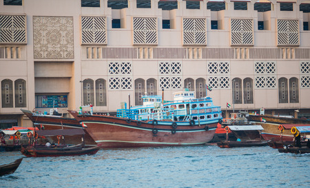 ferries: DUBAI, UAE-JANUARY 18: Traditional Abra ferries on January 18, 2014 in Dubai, UAE. Shipbuilding technology is unchanged from the 18th century.
