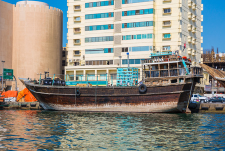 ferries: DUBAI, UAE-JANUARY 20: Traditional Abra ferries on January 20, 2014 in Dubai, UAE. Shipbuilding technology is unchanged from the 18th century.