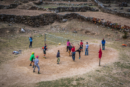 sherpa: SAGARMATHA, NEPAL-APRIL 27: Sherpas football 27, 2016 in Sagarmatha, Nepal. Football at an altitude of more than 3,000 meters on the track to the Everest base camp.