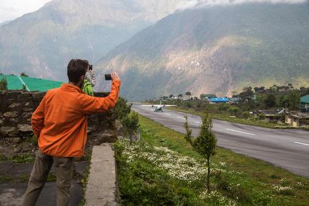 tail fan: LUKLA, NEPAL-MAY 7: Lukla airport 7, 2016 in Lukla, Nepal. The airport in Lukla. First point in way to Everest base camp.