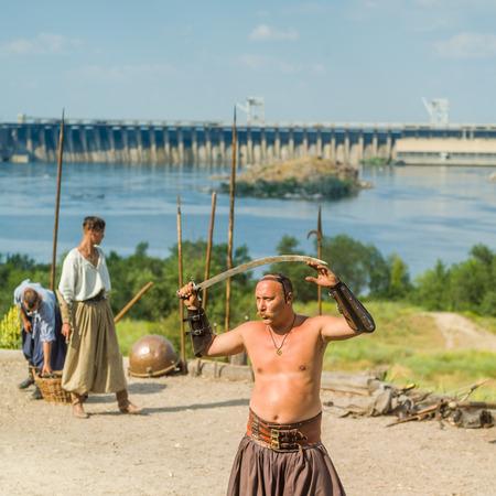 cossacks: ZAPORIZHIA, UKRAINE-JUNE 25: Ukrainian Cossacks 25, 2016 in Zaporizhia, Ukraine. Show of Ukrainian Cossacks in Cossacks Museum on the island of Khortytsya