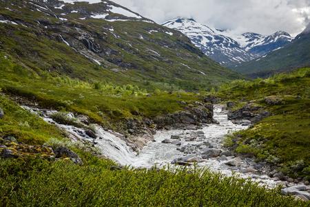 jotunheimen national park: The majestic waterfall in Norway Jotunheimen National Park