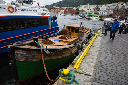 commits: BERGEN, NORWAY-JULY 15: Ferryboat 15, 2016 in Bergen, Norway. Ferry commits a cruise on the fjord.