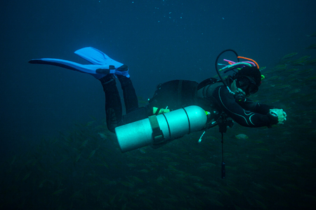 safe water: Scubadiver in a sidemount configuration of equipment
