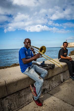 HABANA, CUBA-JANUARY 12: Musican in the city street on January 12, 2018 in Habana, Cuba. People in the city street